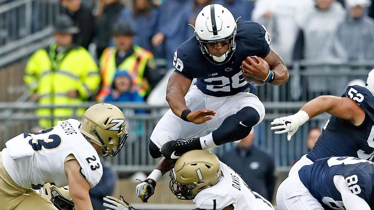 Penn States Saquon Barkley (26) hurdles Akrons Alvin Davis (1) during the first half of an NCAA college football game in State College, Pa., Saturday, Sept. 2, 2017.