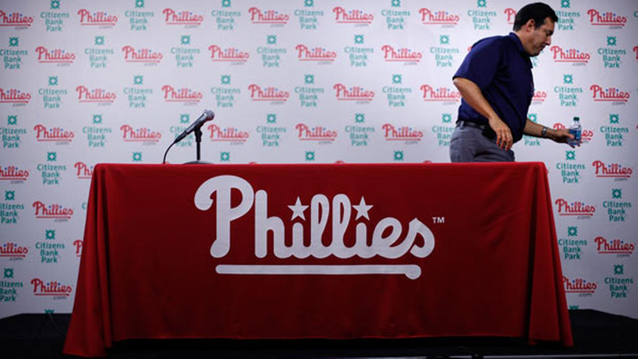 FILE: Philadelphia Phillies general manager Ruben Amaro Jr., exits a news conference Tuesday, Oct. 11, 2011, in Philadelphia. (AP Photo/Matt Rourke)