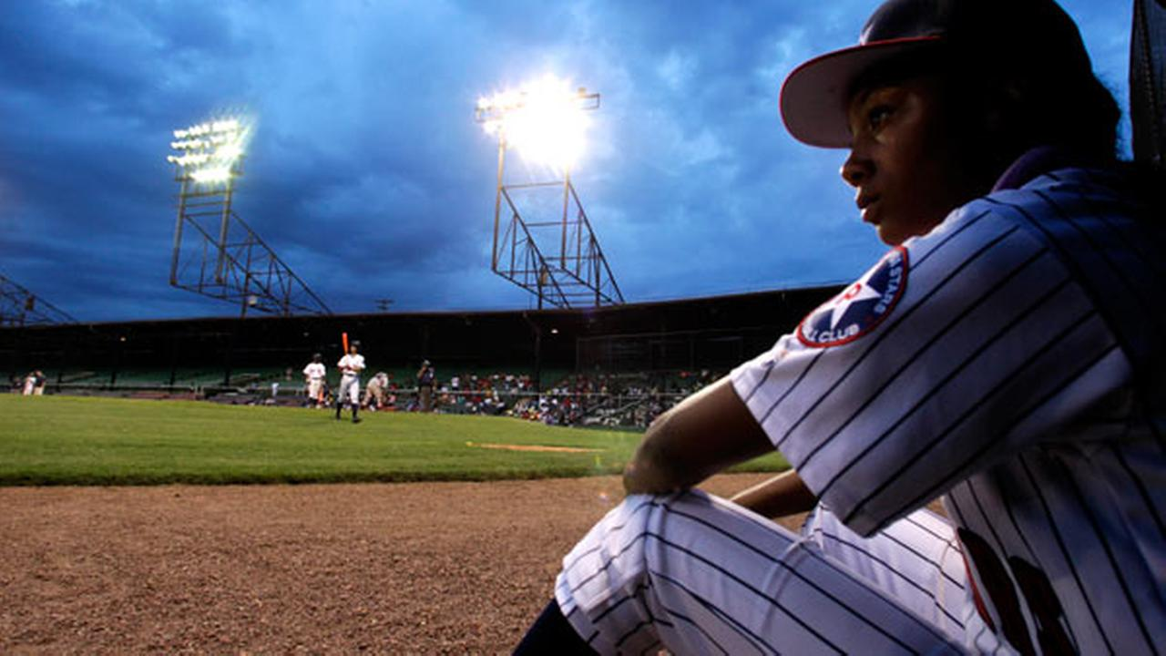 Mone Davis, of the Anderson Monarchs, watches her teammates as the play against the Willie Mays RBI Birmingham team at Rickwood Field, Wednesday, June 24, 2015, in Birmingham, Ala