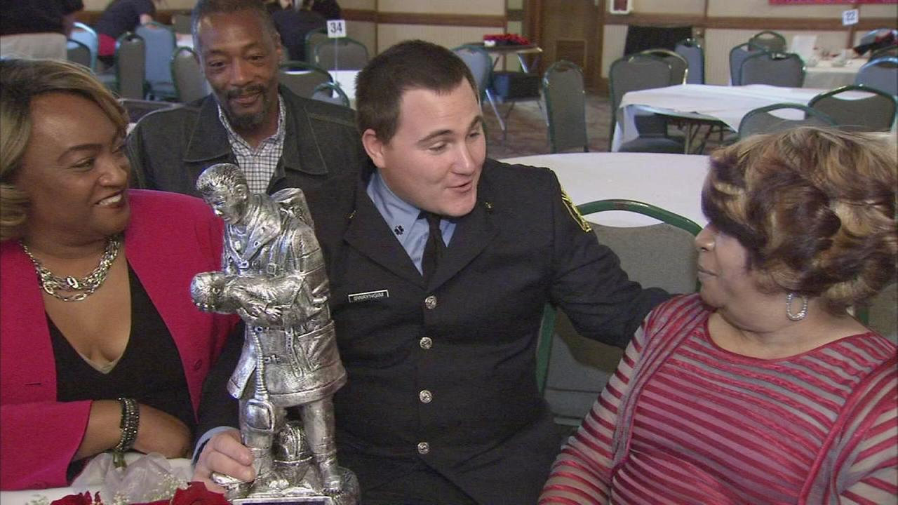 Firefighter honored for saving couple