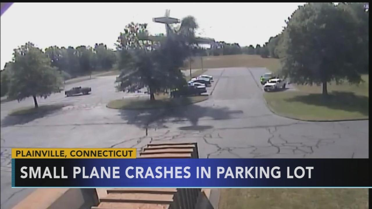 Small plane crashes in parking lot