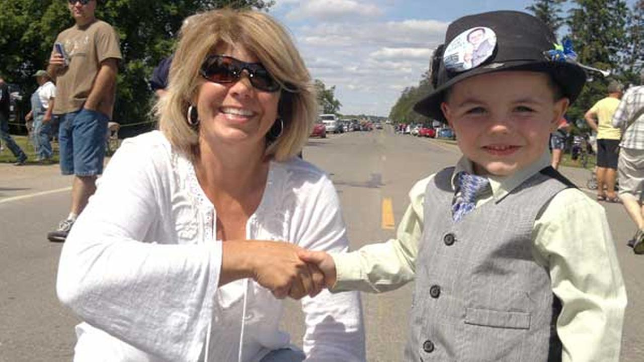 FILE - This handout file photo provided by the Tufts family shows Mayor Robert Bobby Tufts, right, shaking hands with a supporter in the tiny tourist town of Dorset, Minn.