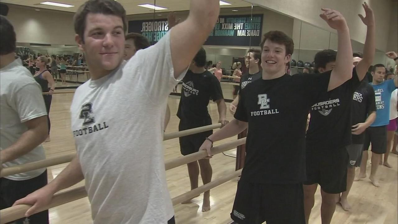 High school football captains try barre