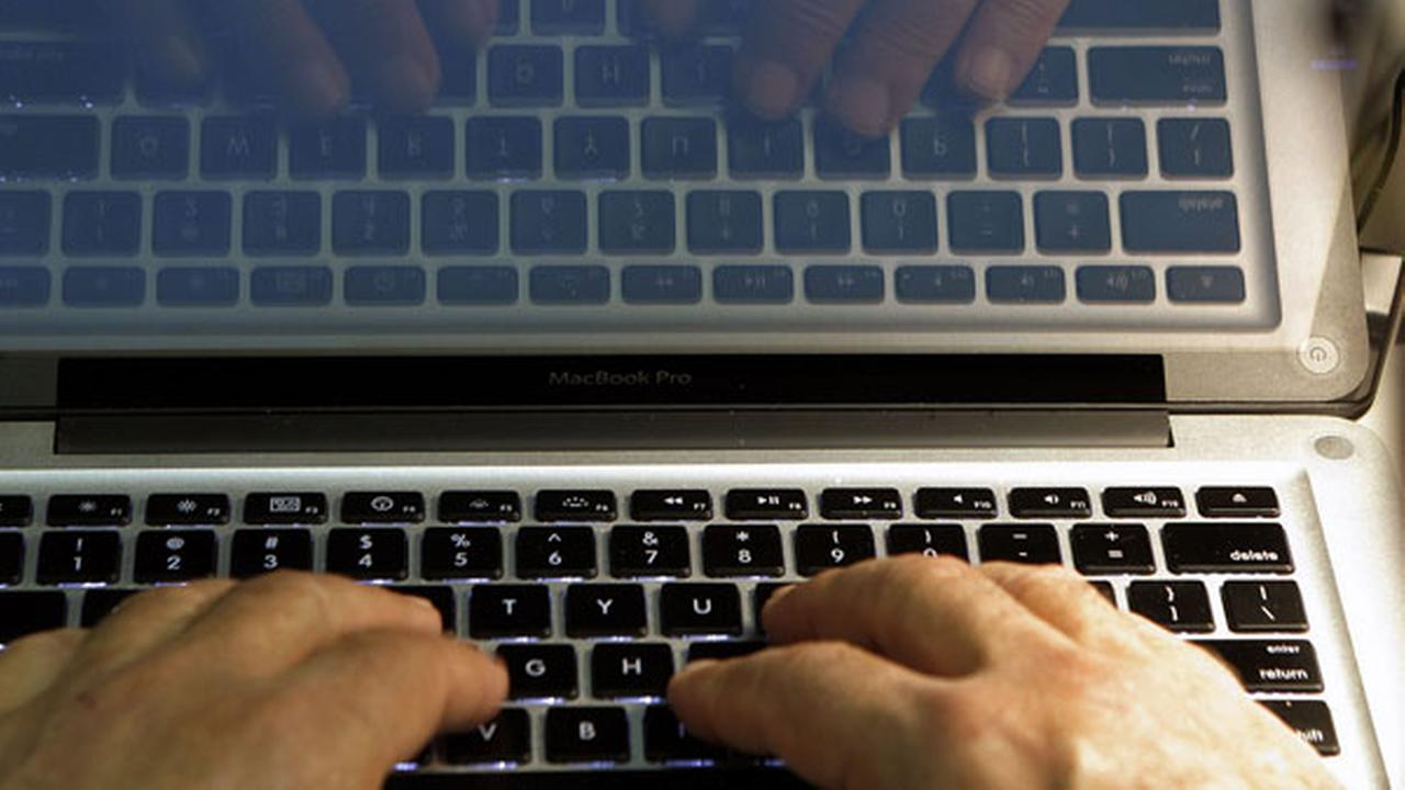 FILE - In this Feb. 27, 2013 photo illustration, hands type on a computer keyboard in Los Angeles.