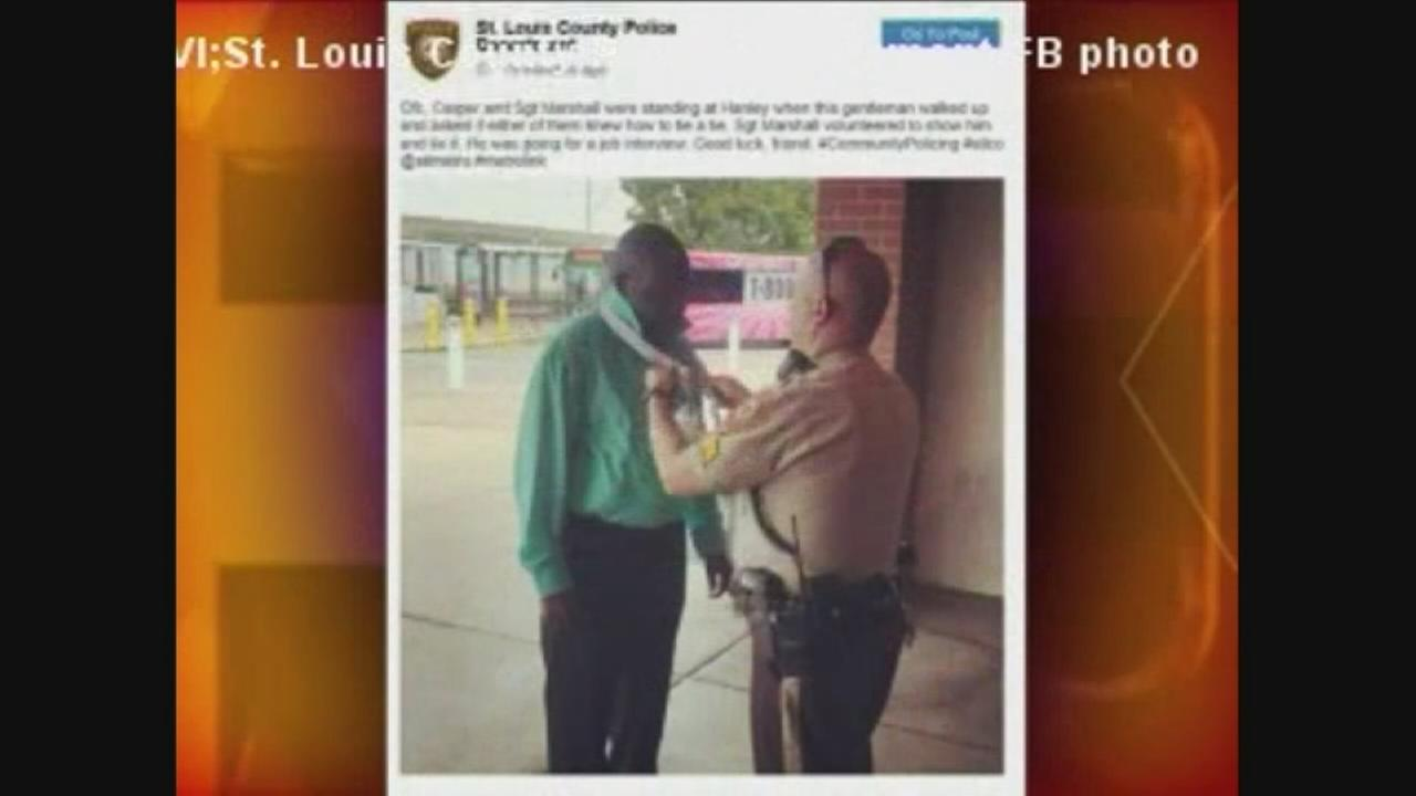 VIDEO: St. Louis police help job hopeful with tie