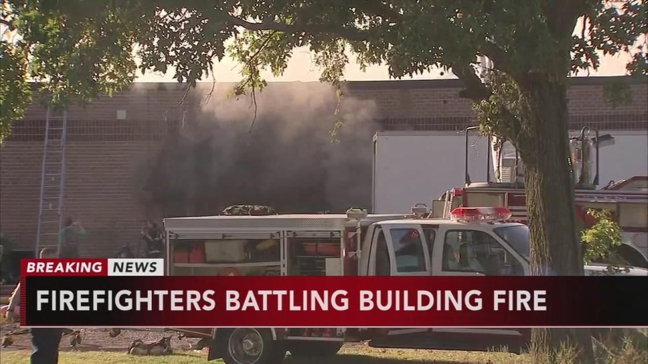 Firefighters battle multi-alarm building fire in Tullytown