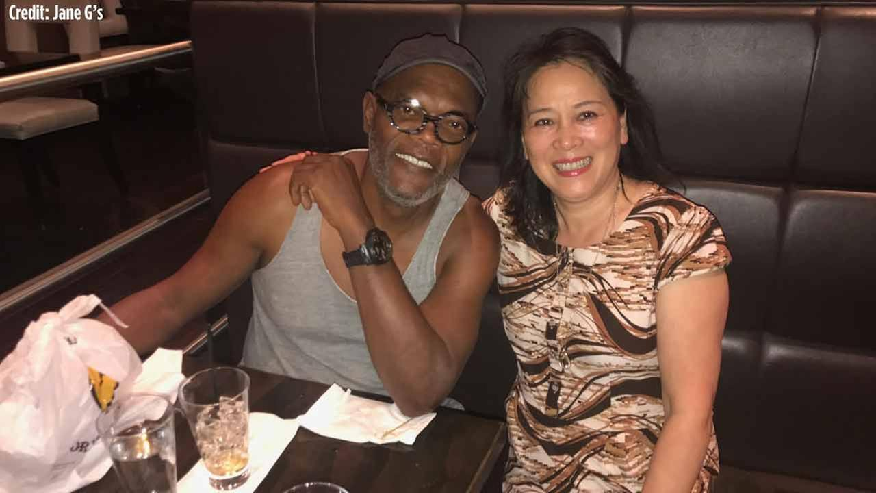 Samuel L. Jackson and restaurant owner Jane Guo pose for a picture on Monday night.