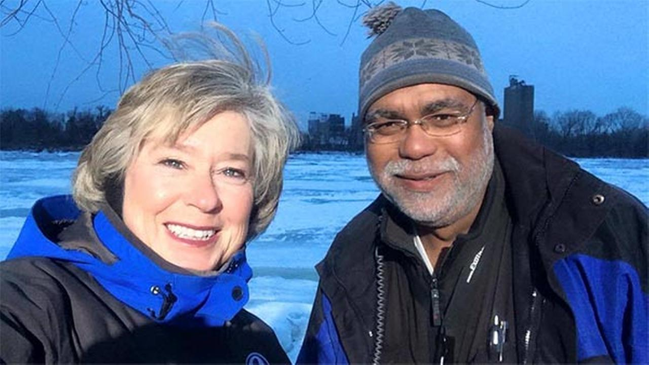 Nora Muchanic and Andy Doane pose in front of a frozen Delaware River.