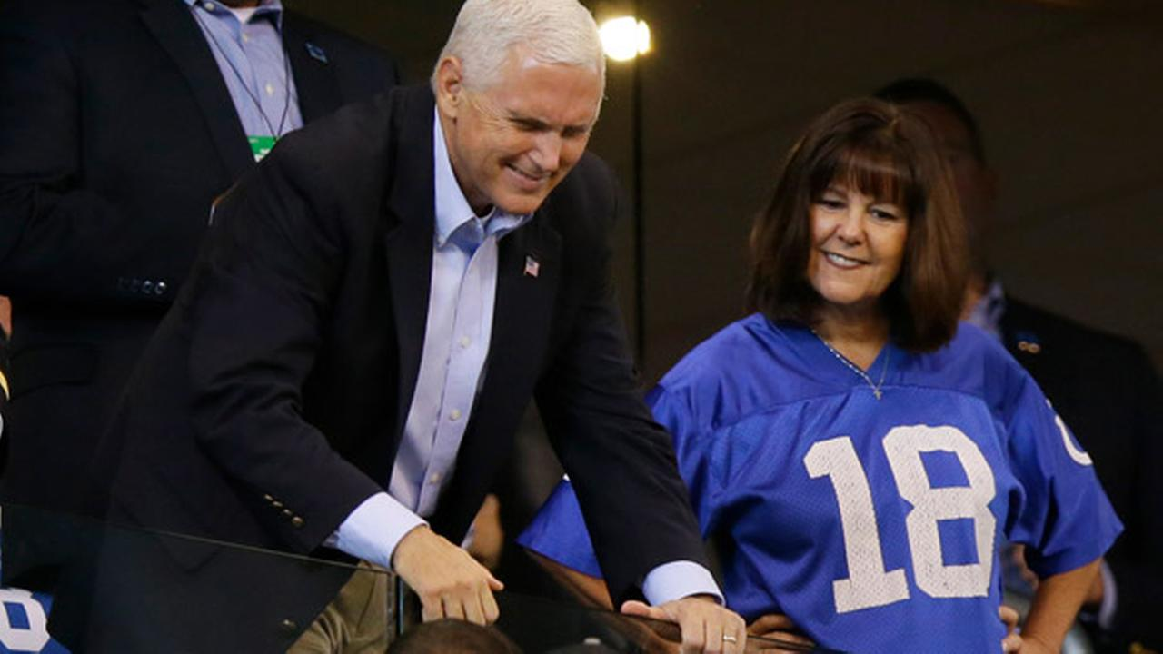 Vice President Mike Pence poses for fans before an NFL football game between the Indianapolis Colts and the San Francisco 49ers, Sunday, Oct. 8, 2017, in Indianapolis.