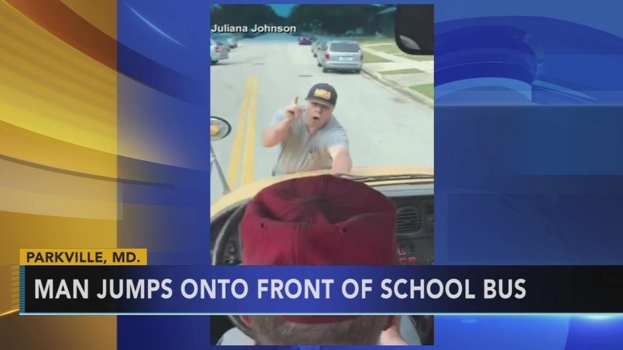 Police say man arrested after clinging to moving school bus