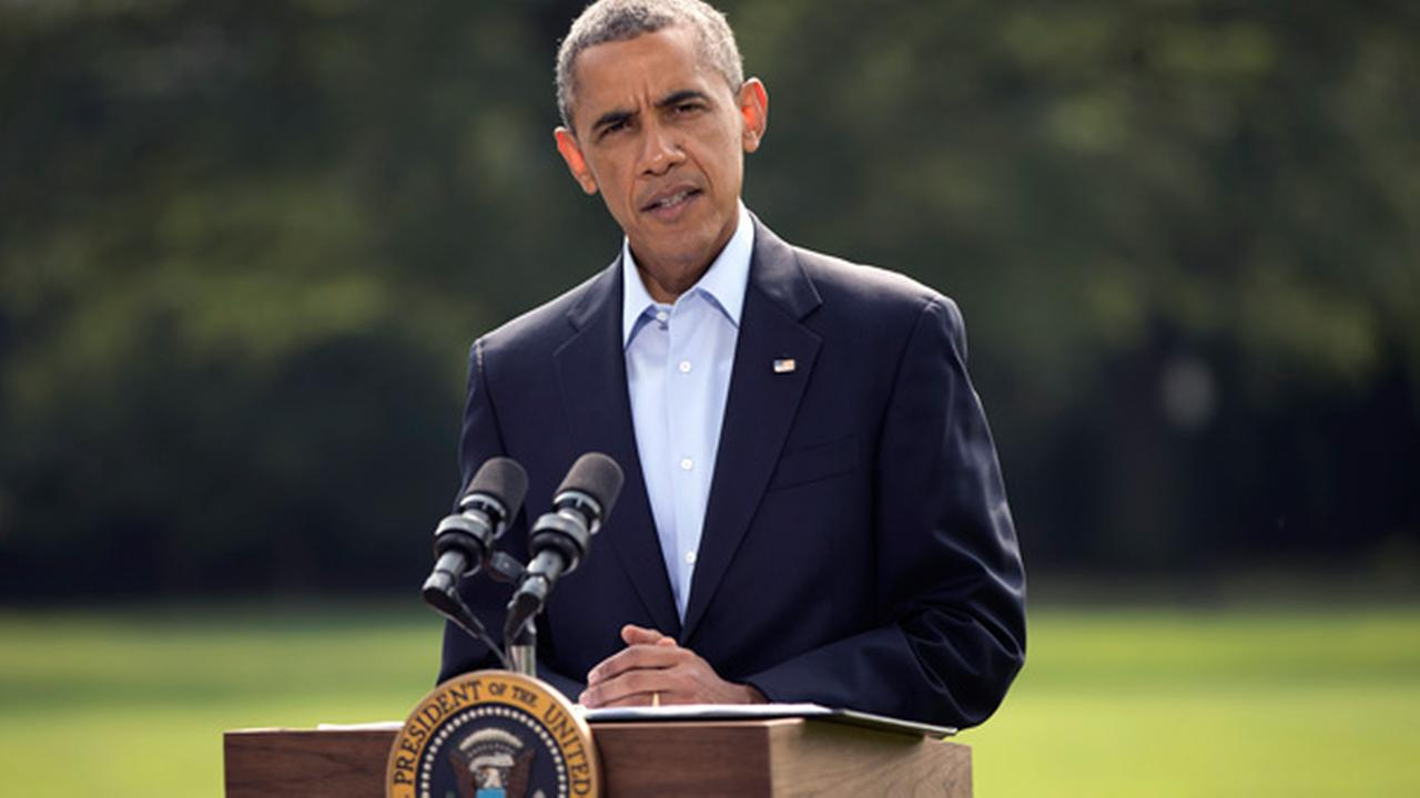 President Barack Obama speaks on the South Lawn of the White House in Washington, Saturday, Aug. 9, 2014, about ongoing situation in Iraq before his departure on Marine One.