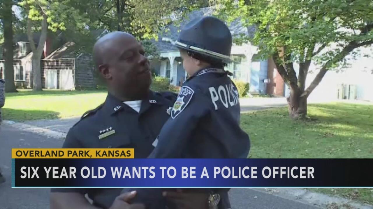 VIDEO: Boy wants to be a police officer, sets up doughnut stand for cops