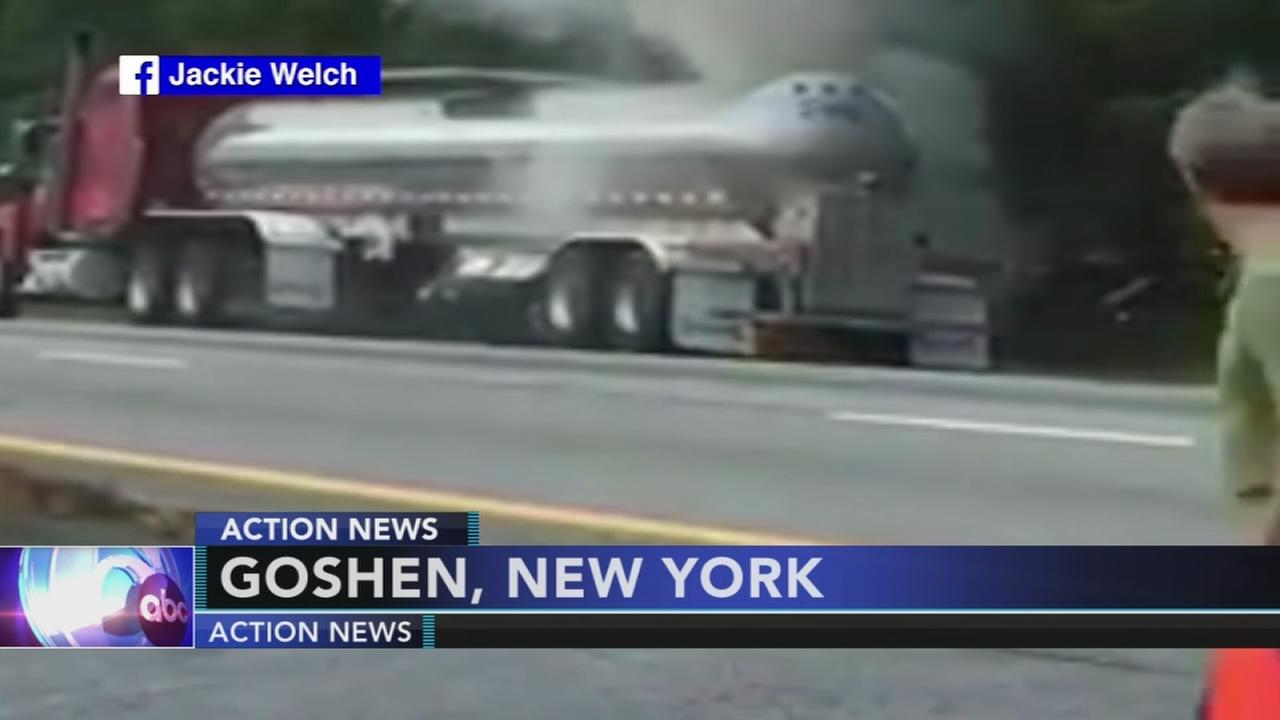 Strangers rush to help couple under burning tanker truck