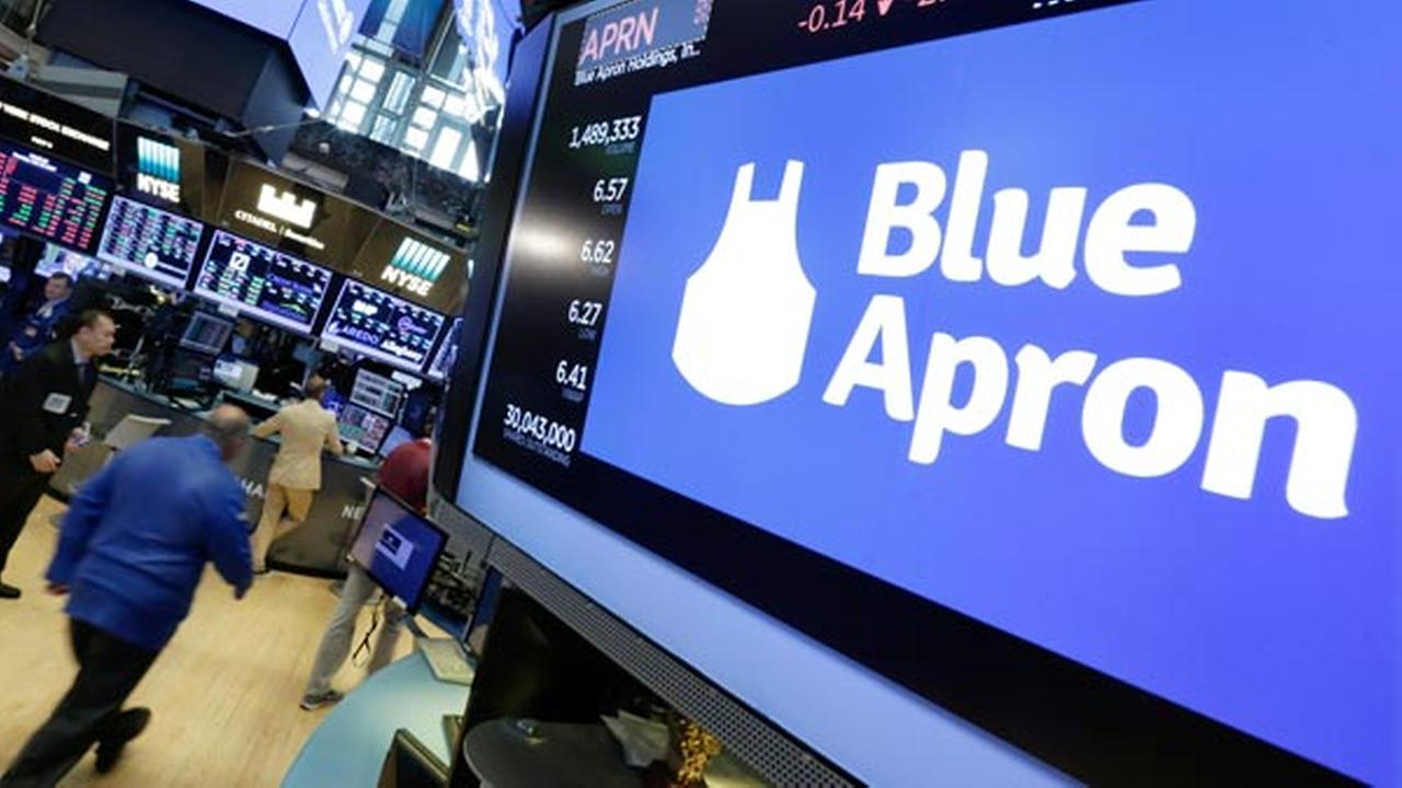 The Blue Apron logo appears above a trading post on the floor of the New York Stock Exchange, Tuesday, July 18, 2017.