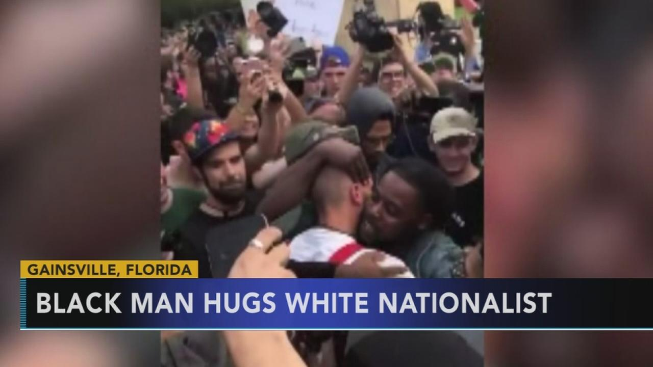 African American man hugs white nationalist during protest