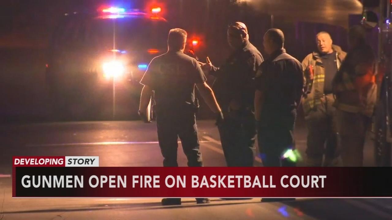 4 hurt after shooters fire from bridge onto basketball court