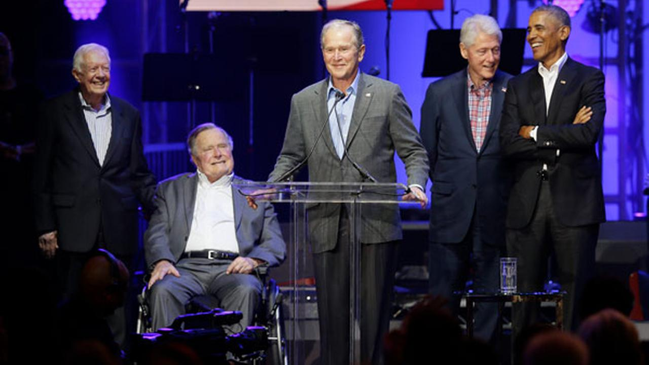 Former President George W. Bush, center, speaks as fellow former Presidents from right, Barack Obama, Bill Clinton, George H.W. Bush and Jimmy Carter.