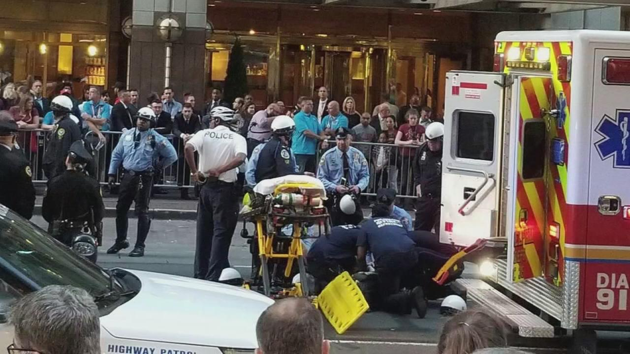 Three police officers during motorcycle unit performance in Center City