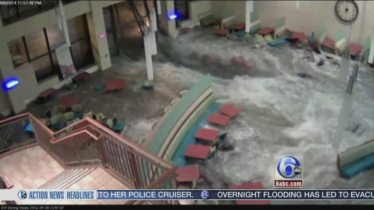 VIDEO: Gushing flood waters burst into hospital cafeteria
