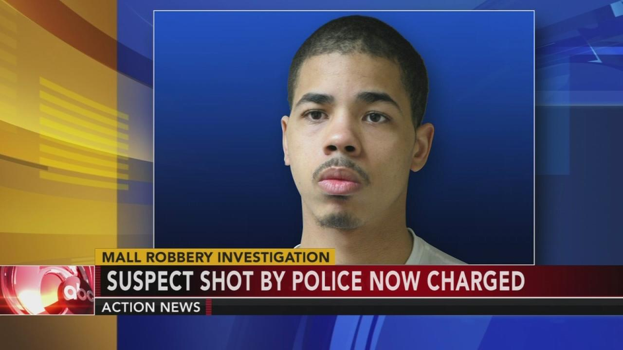 Suspect shot by police near mall charged