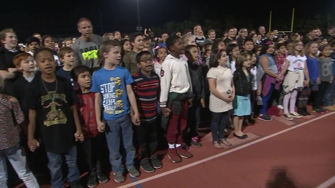 Hundreds take part in singing the national anthem at South Jersey high school football game