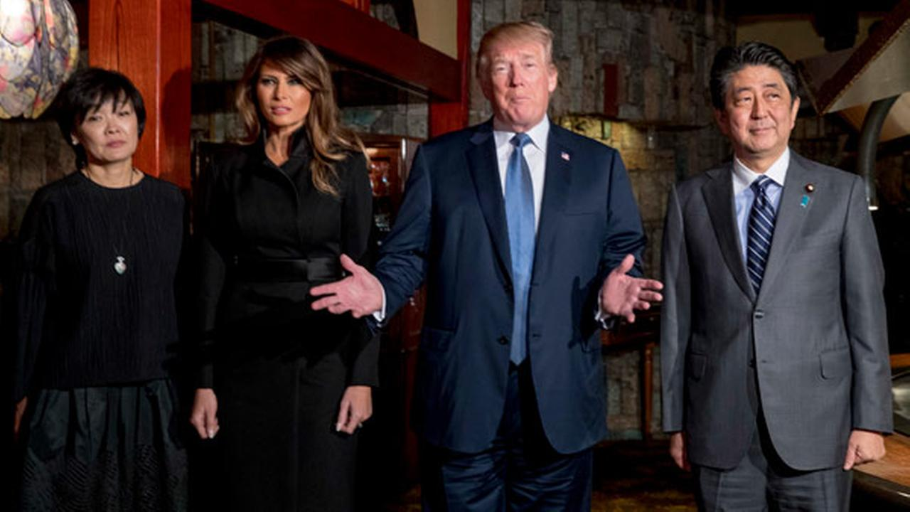 U.S. President Donald Trump, accompanied by first lady Melania Trump, second from left, Japanese Prime Minister Shinzo Abe, right, and his wife Akie Abe.