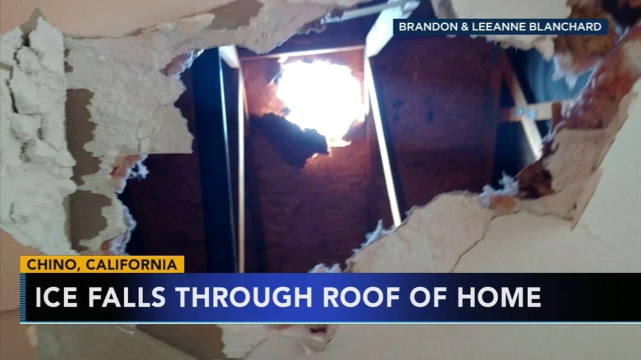 Ice falls through roof of home