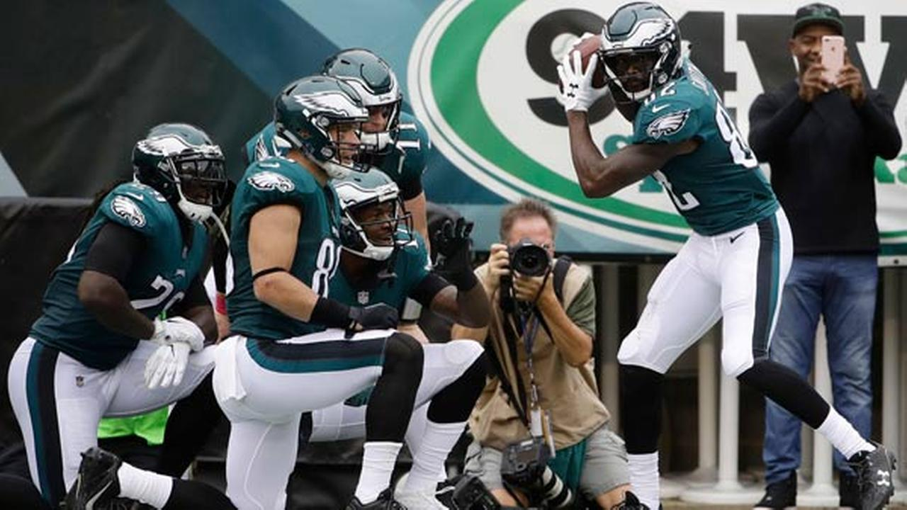 Philadelphia Eagles Torrey Smith, right, celebrates with teammates after scoring a touchdown during the first half of an NFL football game against the Arizona Cardinals.