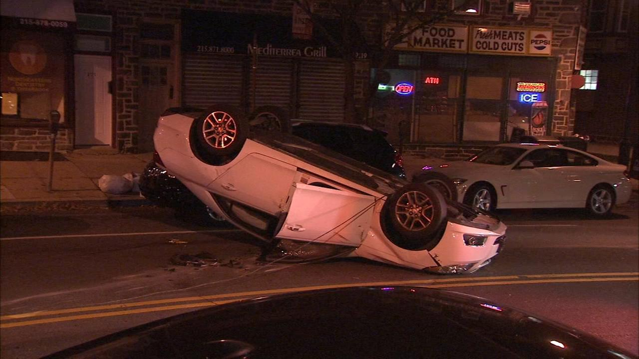 Rollover crash damages cars in Overbrook