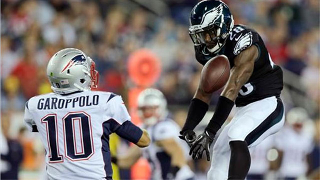 Philadelphia Eagles free safety Earl Wolff (28) knocks down a pass by New England Patriots quarterback Jimmy Garoppolo (10) Friday, Aug. 15, 2014, in Foxborough, Mass.