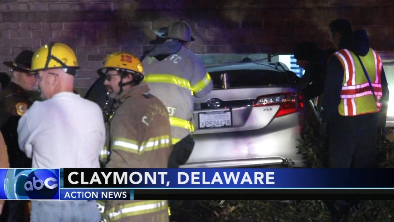 Car plows into Delaware apartment building