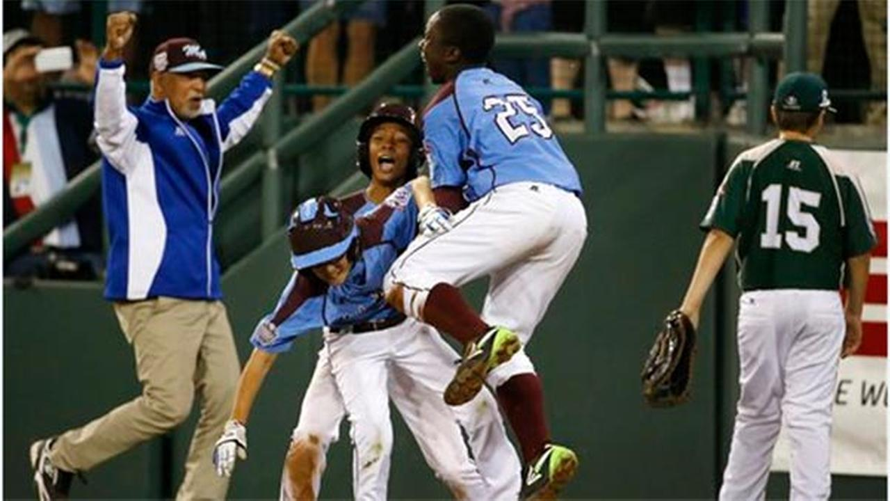 Philadelphias Tai Shanahan, celebrates his walk-off single with teammate Mone Davis, and Zion Spearman in the Little League World Series, Sunday, Aug. 17, 2014.