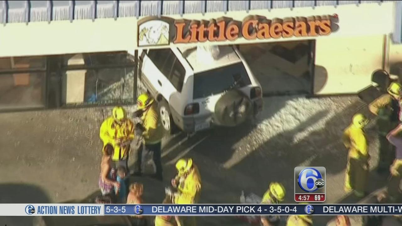 VIDEO: SUV slams into California pizza shop