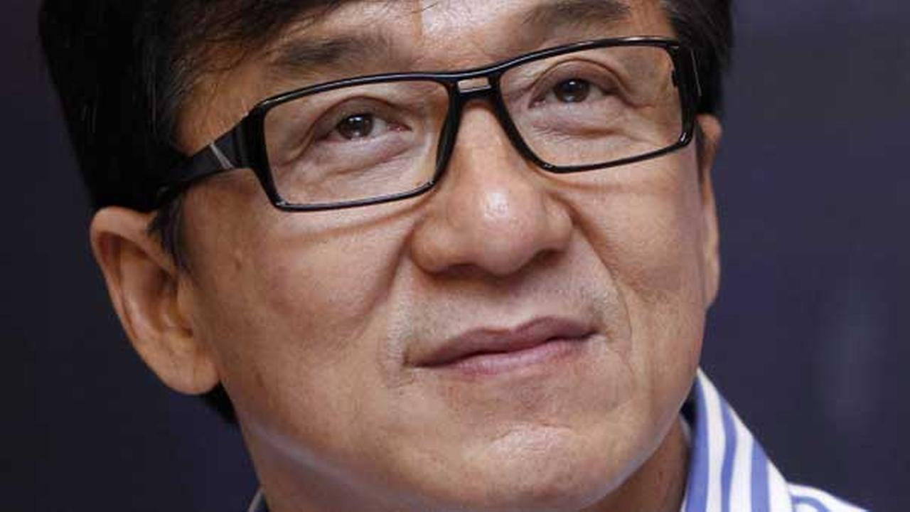 Hong Kong actor Jackie Chan listens to a quastion during a press conference to promote his new film Police Story 2013 in Kuala Lumpur, Malaysia, Wednesday, Dec. 18, 2013.