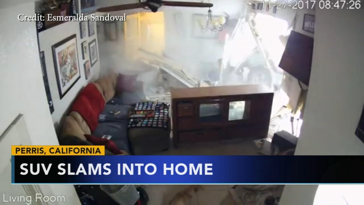 Pets unharmed after SUV slams into home