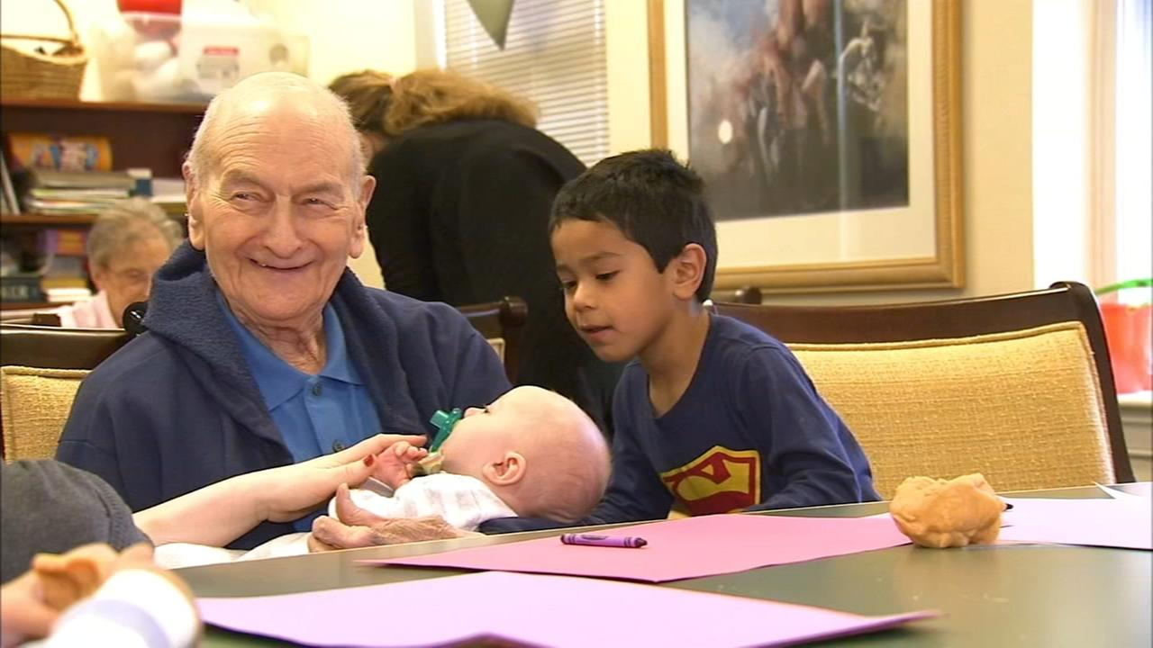 Seniors and children connect as Grand-friends