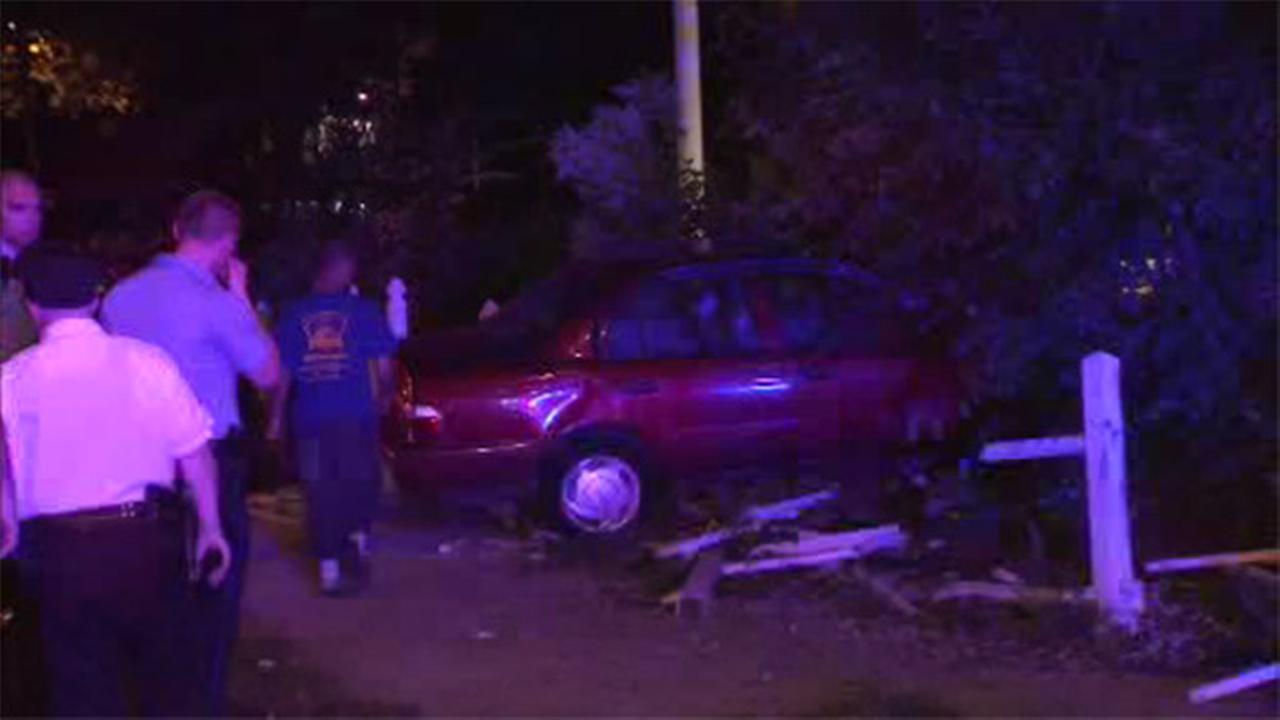Driver hurt after crashing through fence in Northeast Philadelphia