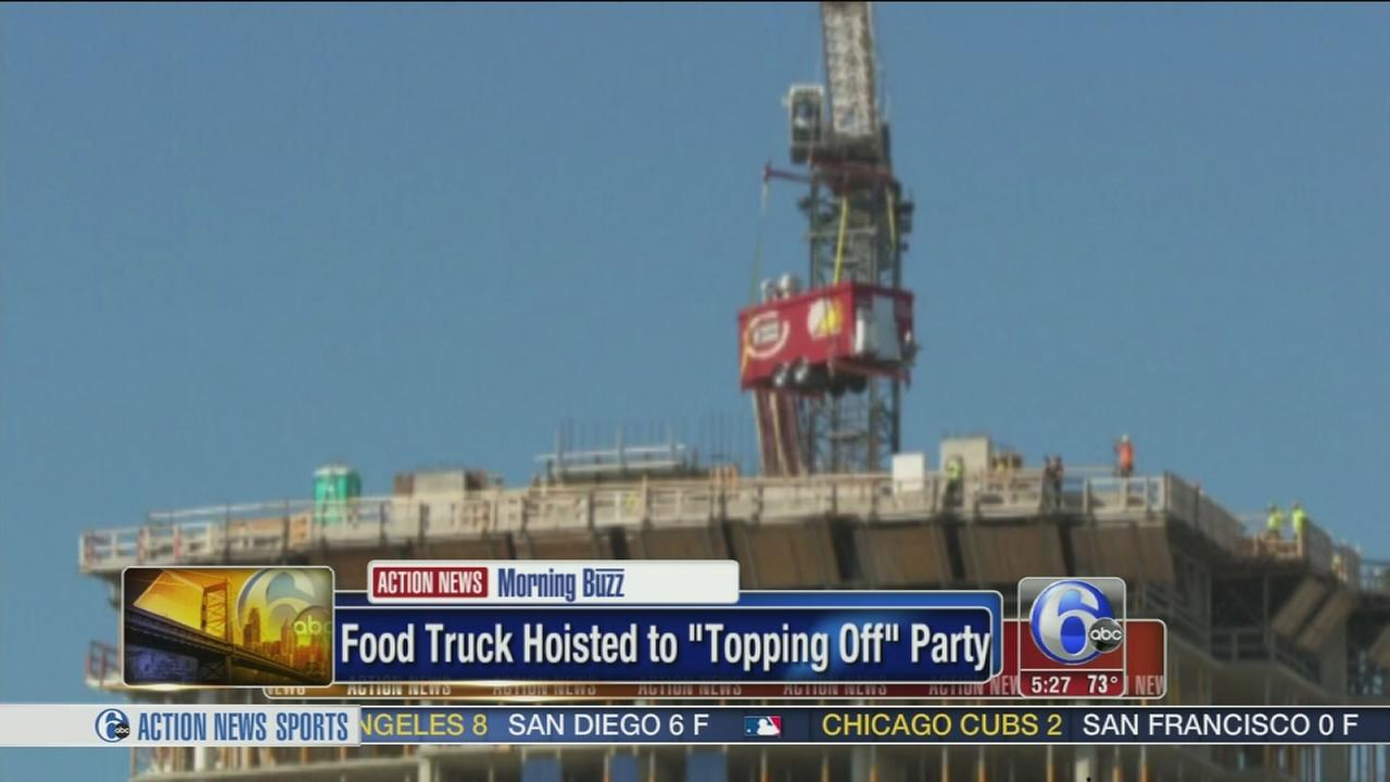 VIDEO: Food truck hoisted to topping off