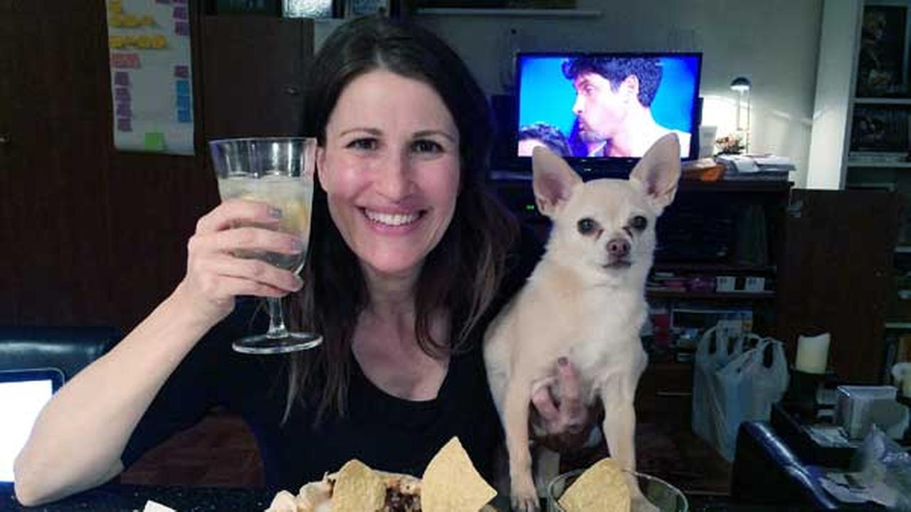 In this May 5, 2014 photo provided by Dana Humphrey, Joanie Pelzer poses with her dog Hubbell, a 9-year-old Chihuahua, in New York.