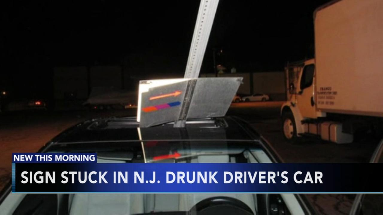 Sign stuck in NJ drunk drivers car