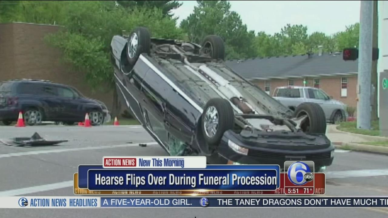 VIDEO: Hearse flips over during funeral procession