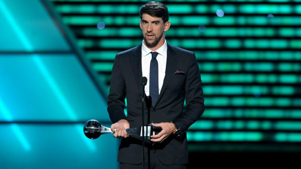 Michael Phelps accepts the award for best record-breaking performance at the ESPY Awards on Wednesday, July 17, 2013, at Nokia Theater in Los Angeles. (Photo by John Shearer/Invision/AP)
