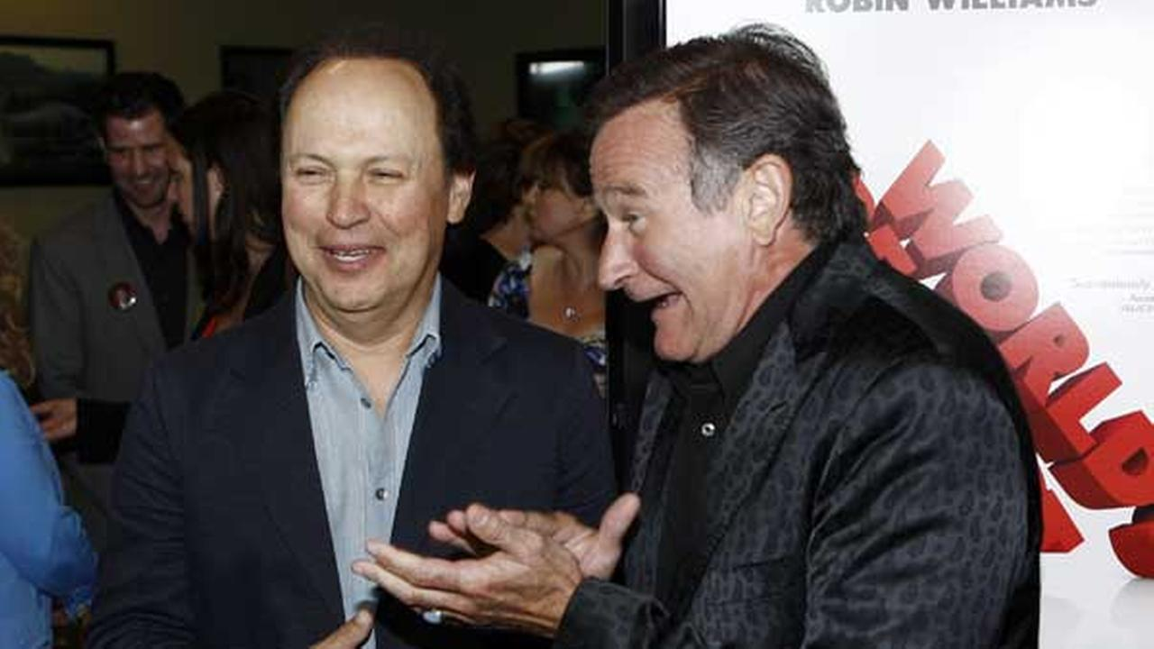 Cast member Robin Williams, right, and Billy Crystal pose together at the premiere of Worlds Greatest Dad in Los Angeles on Thursday, Aug. 13, 2009. (AP Photo/Matt Sayles)