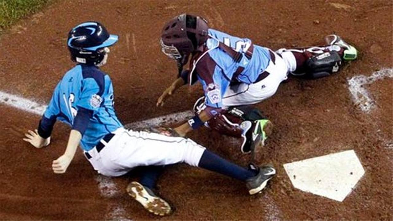 Las Vegas Brad Stone (16) is tagged out by Philadelphia catcher Scott Bandura at the Little League World Series, Wednesday, Aug. 20, 2014.