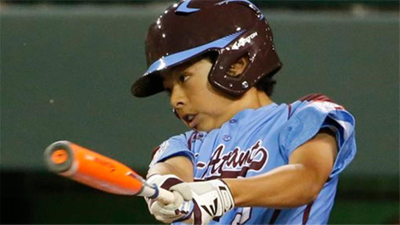 Philadelphias Jack Rice drives in two runs with a single off Chicagos Marquis Jackson in the at the Little League World Series, Thursday, Aug. 21, 2014.