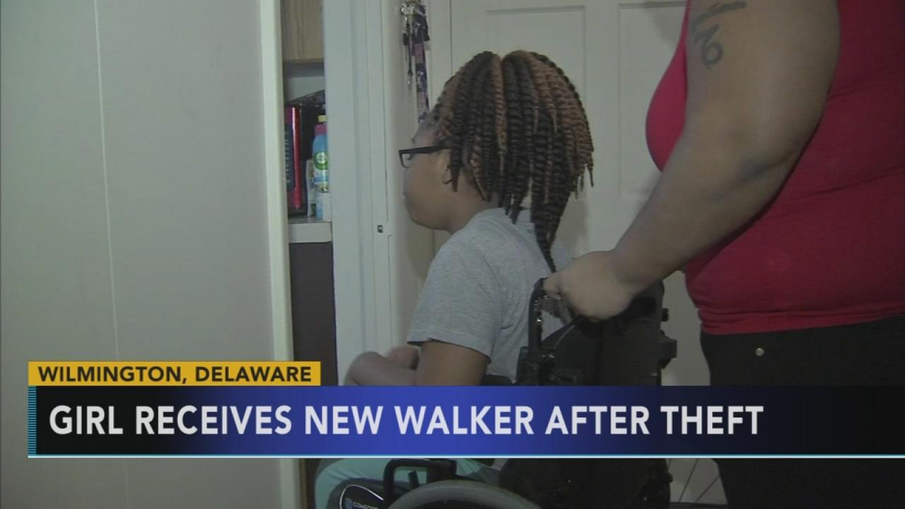 Girl receives new walker after theft
