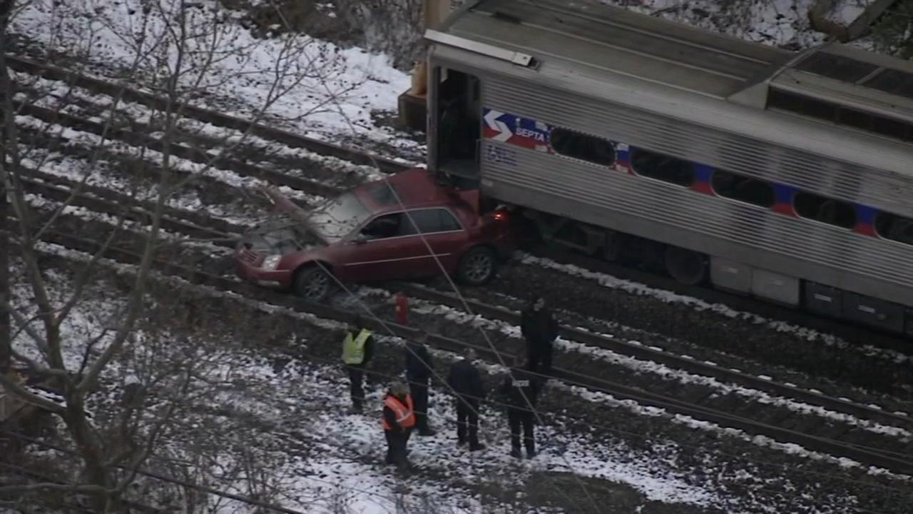 SEPTA train crashes into car on tracks
