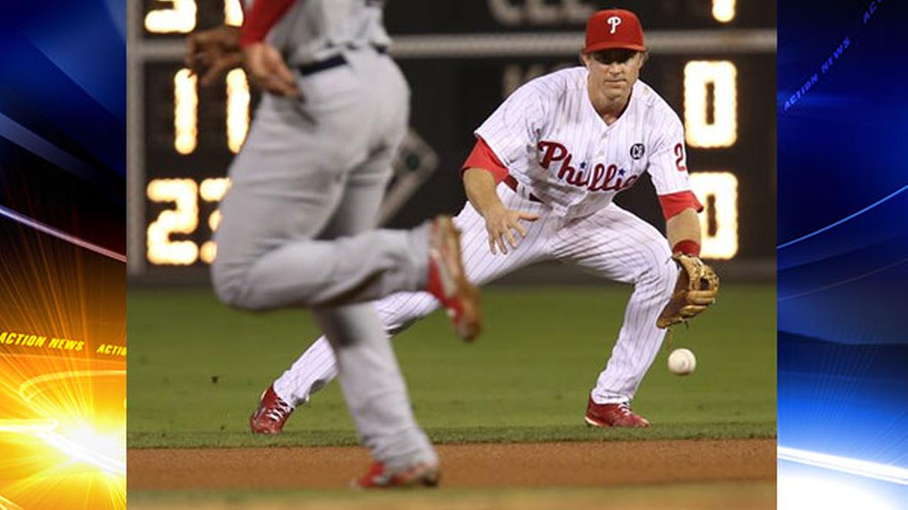 Philadelphia Phillies second baseman Chase Utley, right, and throws to first for the out as Cardinals Oscar Taveras, left, runs to second, Saturday, Aug. 23, 2014.