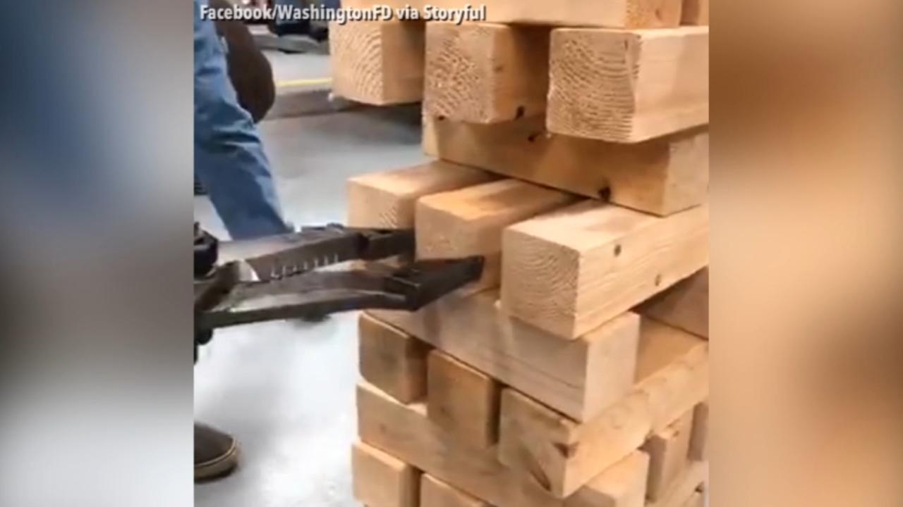 Firefighters partake in game of hydraulic jenga