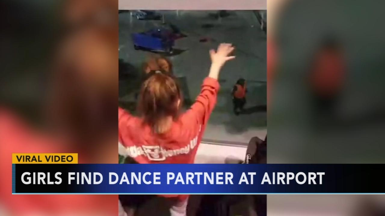 Young girls find dance partner at Dallas airport